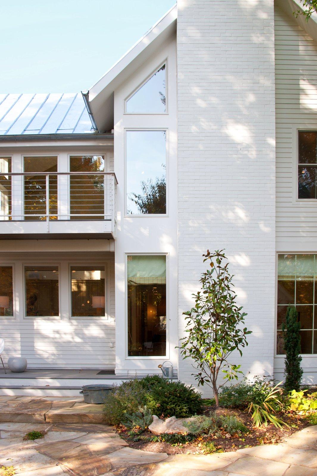 Outdoor, Back Yard, Shrubs, and Stone Patio, Porch, Deck  Urban Farmhouse