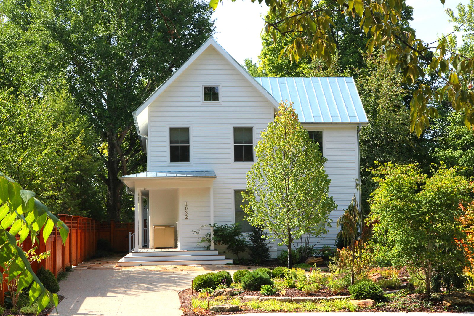 Exterior, House Building Type, Farmhouse Building Type, Gable RoofLine, and Metal Roof Material  Urban Farmhouse
