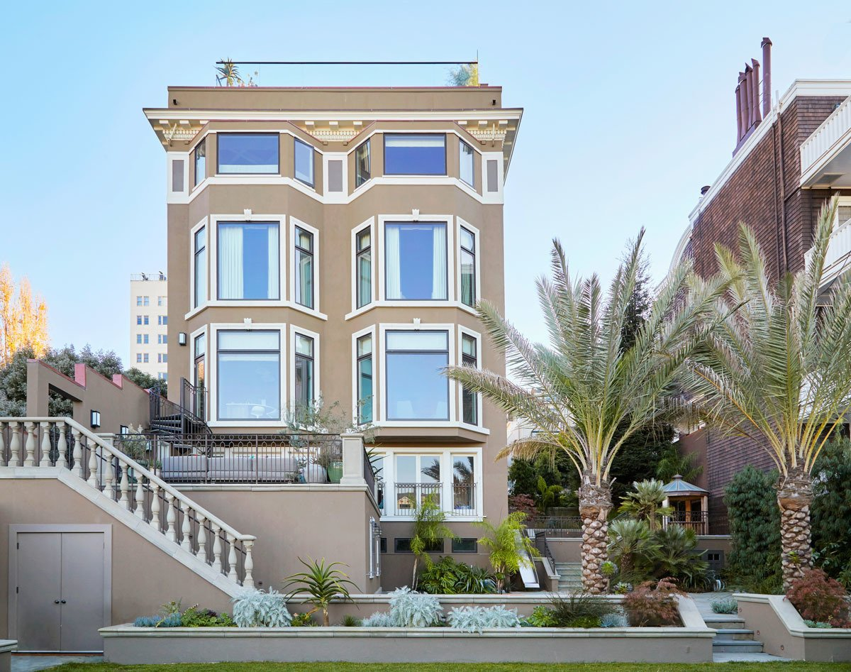 Prior to this project, the rear elevation was a tangled mess of odd sized windows and balconies that were never completed. We gave it symmetry and scale to compliment the orderliness of the rest of the house.  Photo 1 of 9 in 9 Stellar San Francisco Renovations from Pacific Heights Historic Renovation