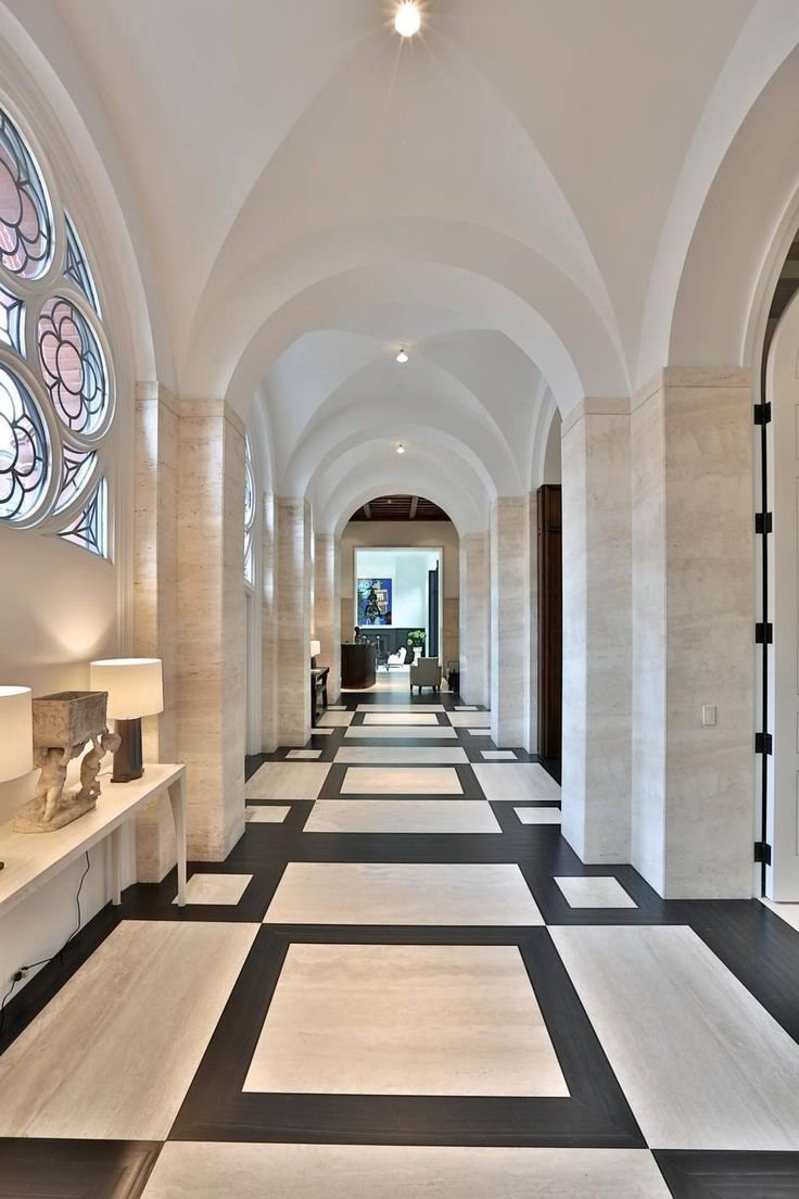 Hallway With no interior partitions to divide up the space, the long side aisle of this converted 1910 church in Toronto, Canada maintains the rhythm of the groin vaults, now plastered over and lit with minimalist fixtures.  Photo 8 of 9 in 7 Repurposed Churches Around the World
