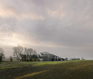 These 4 Modern Homes Around the World Take Advantage of Local Stone - Photo 10 of 16 - From a distance, the fading of the flint reflects the range of colors of the outlying landscape.