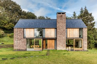 These 4 Modern Homes Around the World Take Advantage of Local Stone - Photo 16 of 16 - The other facades have wood panels as well as local red sandstone.