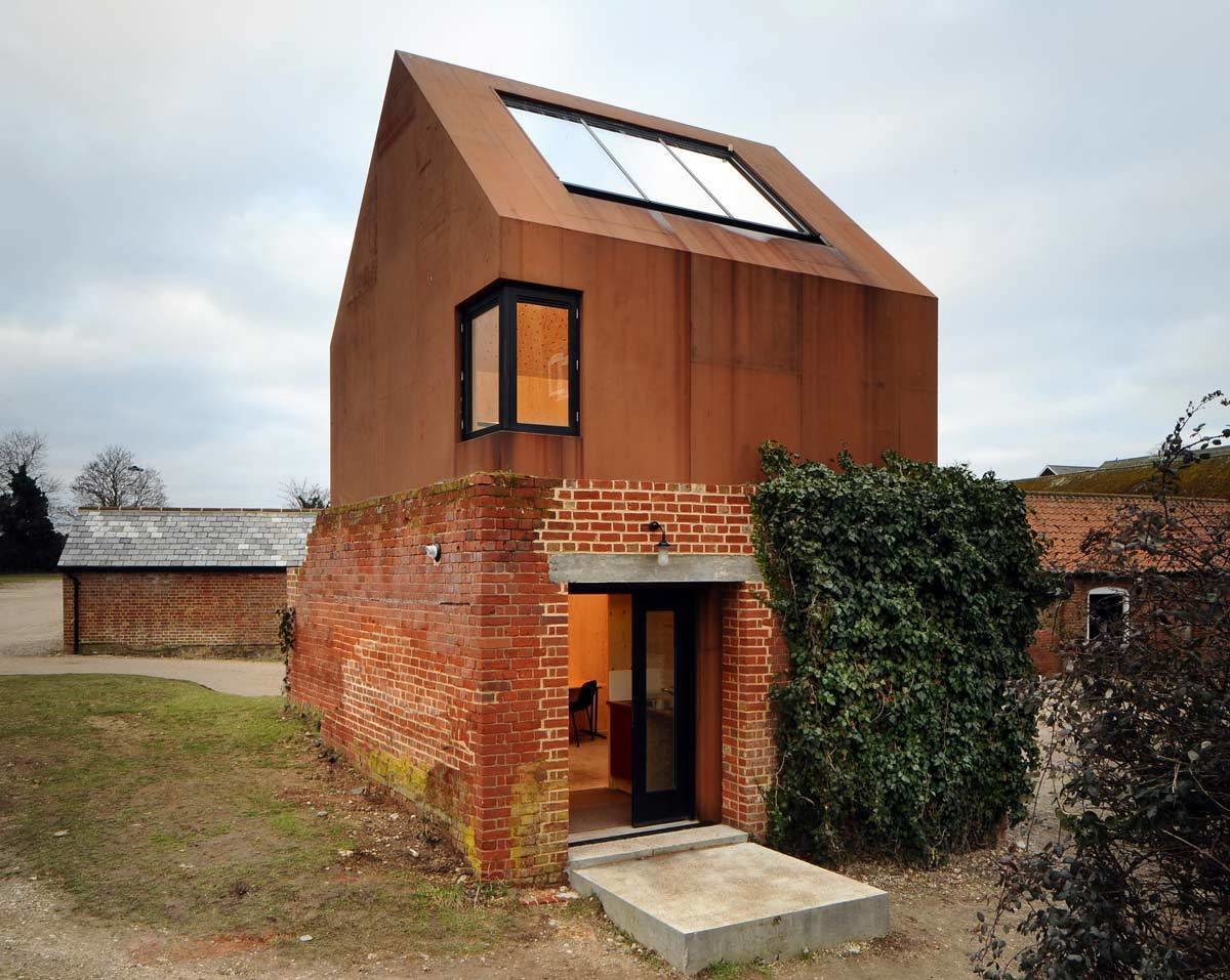 Exterior, Metal Roof Material, Metal Siding Material, Brick Siding Material, and House Building Type  Photos from Rising From the Ruins: Homes Built on Architectural Remains