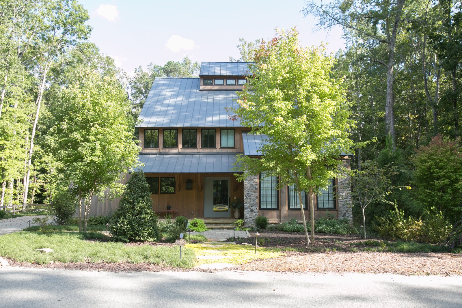 Single-family homes range in size and style to appeal to a variety of residents.  Photo 5 of 11 in An Eco-Friendly Community Outside of Atlanta Celebrates Nature and Sustainability