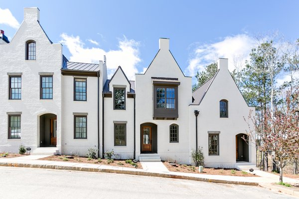 Even in townhouses located next to each other are distinct while using the same architectural language.  Photo 9 of 11 in An Eco-Friendly Community Outside of Atlanta Celebrates Nature and Sustainability