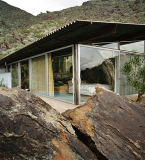 The Frey II House embedded in the rocky hillside of Palm Springs