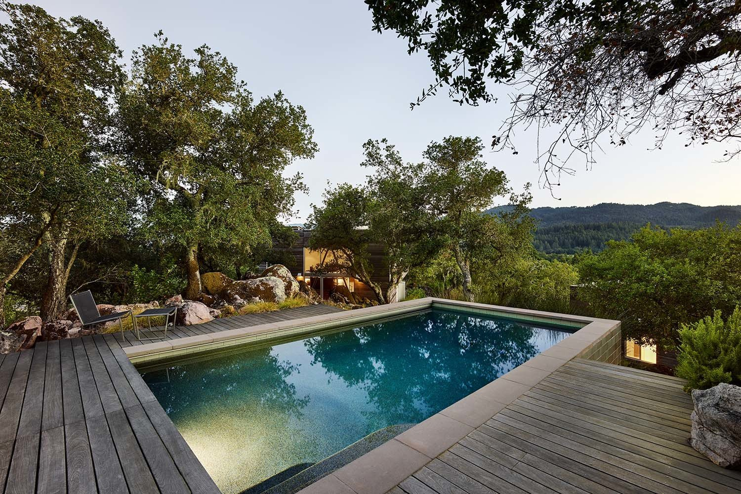 Outdoor, Infinity Pools, Tubs, Shower, Trees, Shrubs, Decking Patio, Porch, Deck, Wood Patio, Porch, Deck, and Boulders  Photo 11 of 14 in Discover a Nature-Immersed Retreat For Sale in the Heart of Wine Country