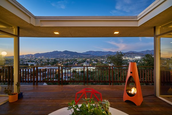Outdoor and Wood Patio, Porch, Deck Beautiful vistas of the city are the centerpiece of this show-stopping home.  Photo 3 of 14 in A Midcentury-Modern Home in L.A. Designed by Richard Banta Is For Sale For $899K