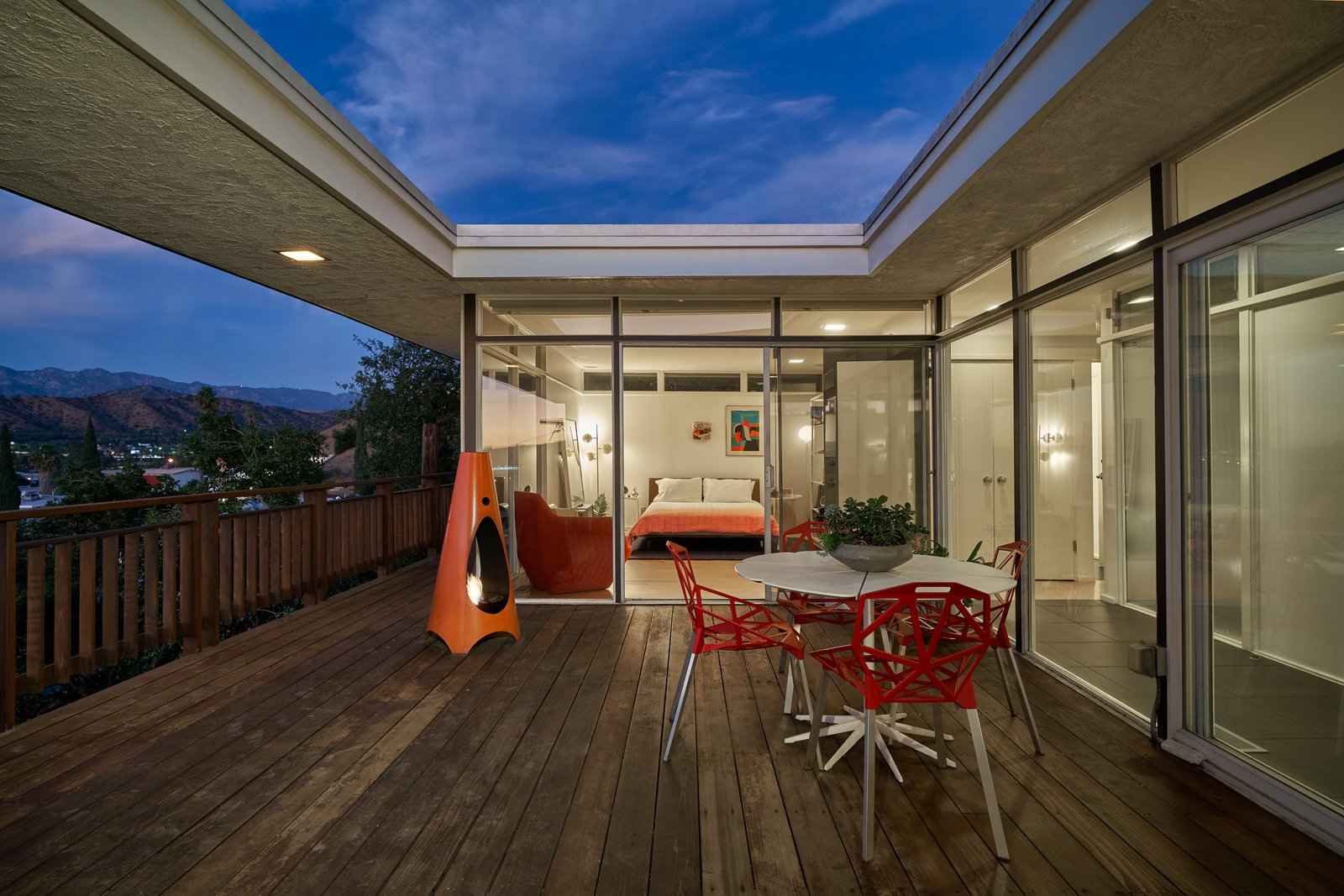 The bedrooms are located on one wing of the H-shaped house, with the kitchen/dining/living area on the other. Tagged: Outdoor and Wood Patio, Porch, Deck.  Photo 4 of 14 in A Midcentury-Modern Home in L.A. Designed by Richard Banta Is For Sale For $899K