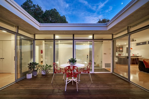 Outdoor and Wood Patio, Porch, Deck The patio is open to the sky above, allowing for light to flood the rooms that surround it.  Photo 5 of 14 in A Midcentury-Modern Home in L.A. Designed by Richard Banta Is For Sale For $899K