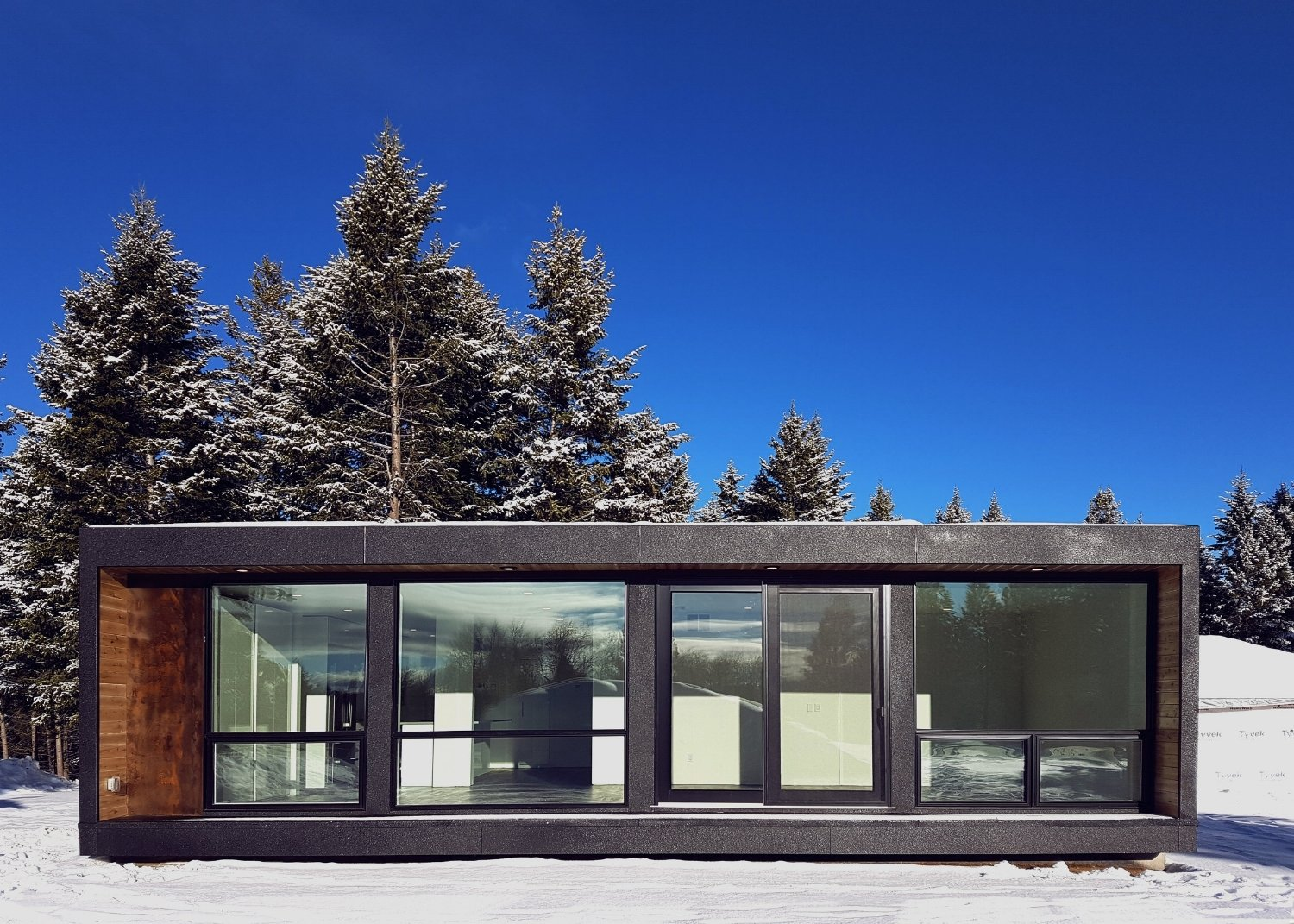 Exterior, Flat RoofLine, House Building Type, Shipping Container Building Type, Wood Siding Material, and Glass Siding Material The HO4 by HONOMOBO  Photo 3 of 11 in 10 Shipping Container Homes You Can Buy Right Now