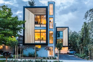 Consisting of three prefabricated units in West Seattle on a 5,000-square-foot lot, the townhomes range from 1,250 to 1,400 square feet, and each have three bedrooms and two and a half bathrooms. The generous glazing of the living rooms are set back from the exterior cedar rainscreen, and the rest of the facade is sheathed in metal panels. The ground floor was built onsite, and the upper two floors were prefabricated offsite in a factory.