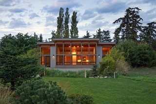 In a small community with a shared garden, FabCab built this prefab home, which integrates high-quality materials to keep the dwelling from feeling clinical, despite its construction in a factory. The architects also incorporated universal design features to make the homes both appropriate and comfortable for aging clients.