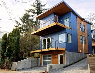 Perched on a steep urban hillside, this three-bedroom, two-bath home features energy-efficient elements including triple-glazed windows and FSC bamboo floors to achieve LEED Platinum certification. Even the home's garage was designed to be sustainable, as it is prewired for electric charging. The design's emphasis on livability and openness are also reflected by ample outdoor terraces, as well as the flexible basement.