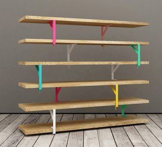 Functional, colorful, and minimal design—that's what you get when several of IKEA's Ekby Tygvve Mensola wooden shelves are held up by IKEA's versatile Cekby Tore brackets. The team behind Teste de Legno shows how the entire shelf sits on caster wheels, allowing the unit to be easily moved.