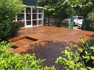 Good Times Decking makes prefabricated decking kits, mostly available in Australia, in a range of different woods, including treated pine and merbau, and different sizes. They also offer kits made out of composite decking material in a reddish tone, brown, and gray.