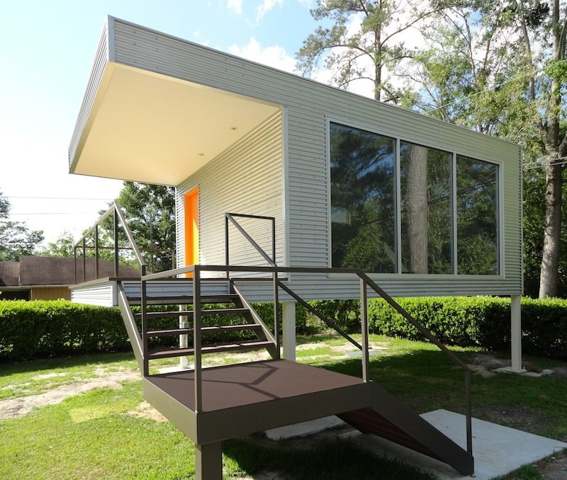 Exterior and Prefab Building Type Designed by Phoenix-based ASUL—which stands for adaptable system for universal living—and CSCP Consult in Savannah, Georgia, this is not a full-fledged home but rather an accessory dwelling unit, known as an ADU. Its 16-foot by 20-foot interior is cozy and practical, inspired by the midcentury main house adjacent to the building, which is used as an office, library, and study. The ADU rests on 6-foot stilts to comply with FEMA flood zone requirements.  Photo 3 of 4 in 4 Innovative Prefab Homes in Georgia