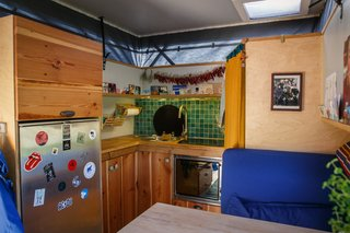 The kitchen countertops connect the travelers to their former residence in Berlin; the wood was taken from a neighbor's house and was slated for the dumpster. The pine was instead rescued and used to create the kitchen countertops and cabinet doors.