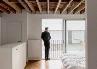 Bedrooms on the upper floors maintain the neutral palette established on the levels below.