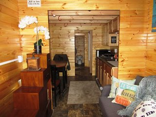 Real Wood Tiny Homes designs tiny homes and compact pre-engineered buildings that are transportable, semi-permanent, or permanent. Their buildings all use a unique tongue-and-groove construction technique where wood boards interlocks with adjacent pieces—the wood is also treated for fire protection and rot. The homes are designed to be sustainable, and feature a proprietary water cycle management system that conserves fresh water, collects rainwater, and recycles gray water for irrigation.