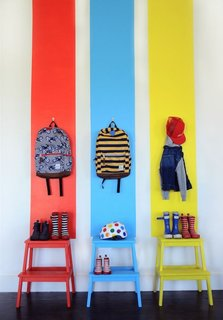 Painted wooden IKEA stools perk up an entire wall.