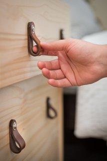 Leather drawer pulls by Walnut Studio.