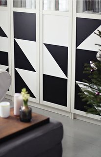 A geometric pattern created with black contact paper enlivens this IKEA cabinet.