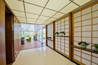 When entering the house, visitors are greeted with a series of original rice-paper screens imported from Japan.