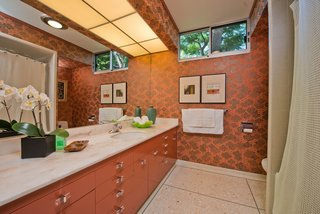Most of the property's bathrooms have original features, including Japanese wallpaper and midcentury hardware.