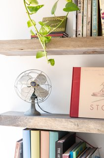 Items on the shelf were artfully arranged to show a mix of objects, art, and books.