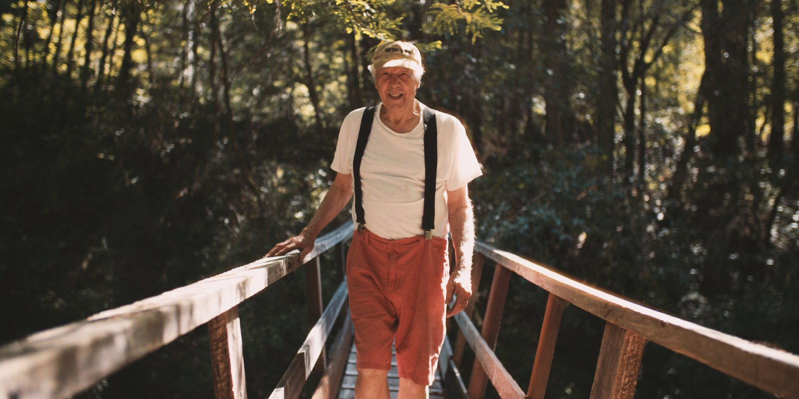 84-year-old Charles Bello left the world of California modernism in the 1960s to embark on his own nature-inspired, architectural journey among hundreds of acres of redwoods in Northern California.  Photo 2 of 10 in The Parabolic Glass House in Northern California Is One Architect's Utopia in the Redwoods