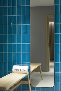 The hotel's spa, with walls tiled in a calming blue tone, also uses products from a local company.