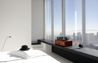 Minimalist glamour in the form of fine finishes, tall ceilings, large windows, and white walls are found at the Distrito Capital Hotel in Mexico City's skyscraper district, Santa Fe.