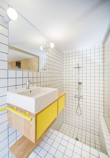 The tub and shower are sunken, reflecting the two levels in the rest of the apartment.