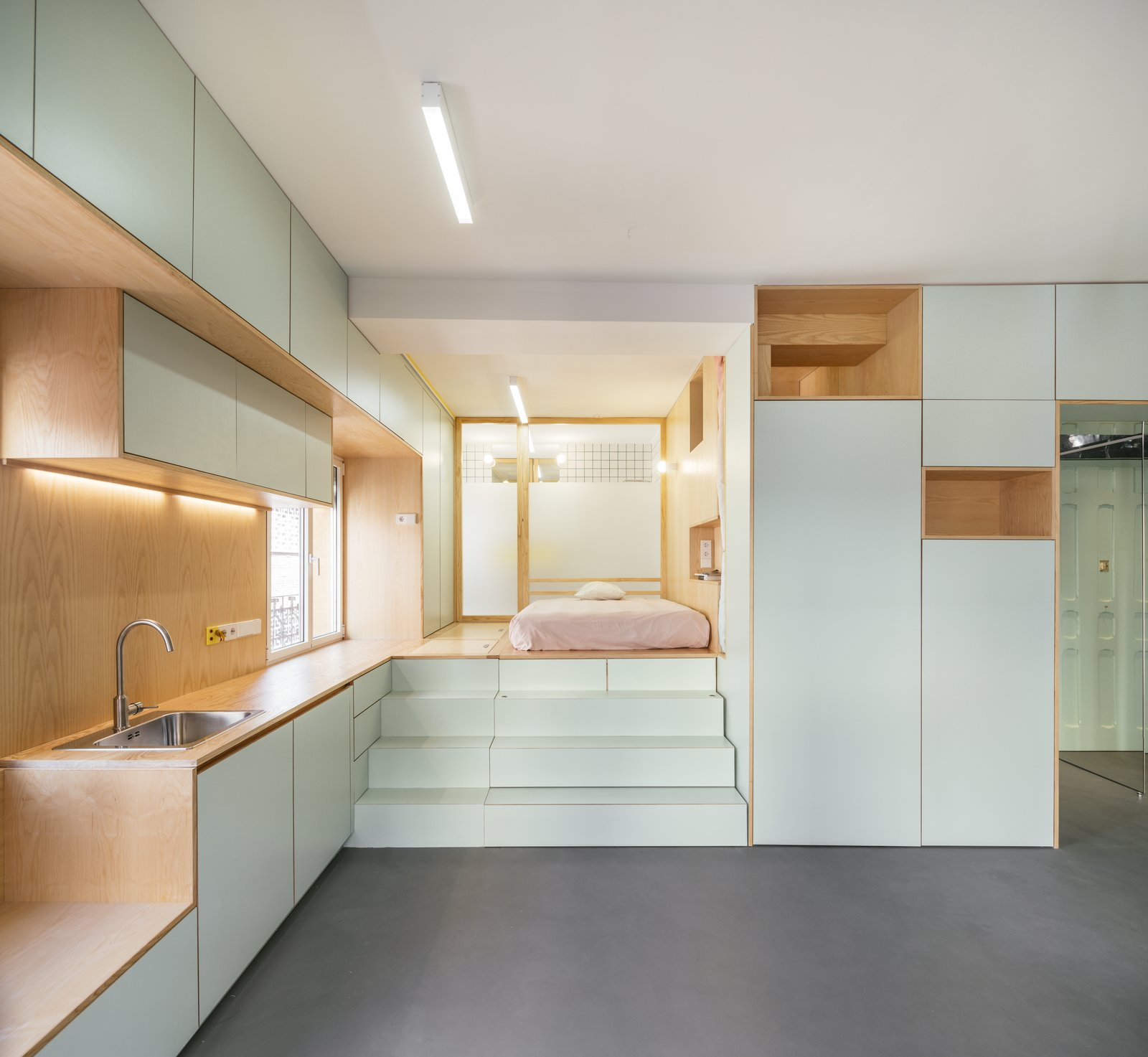 Secret Storage and Pastel Colors Outfit a 350-Square-Foot Apartment in Madrid