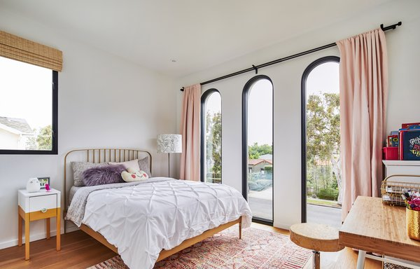 The master bedroom faces the street. Three dramatic arched windows at the front of the house fill the interior with light.