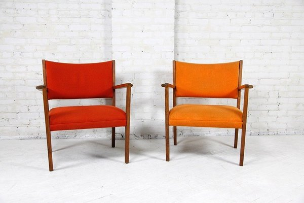 Midcentury lounge chairs in eye-popping red and orange by Jens Risom.