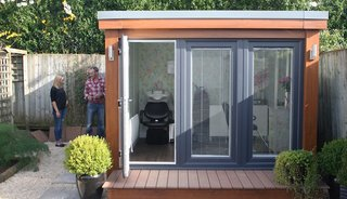 This modern garden shed, which measures about 9' x 9', was customized to function as a hair salon complete with hair sinks, salon chairs, and other equipment and furniture.