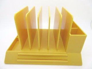 A bright yellow V-87 desk organizer by Max Klein
