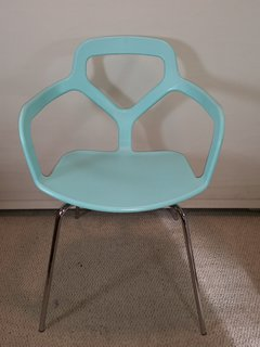 The playful transitions from solid to void and the bright turquoise color of this chair make it a great fit for homes that have a lot of neutrals.