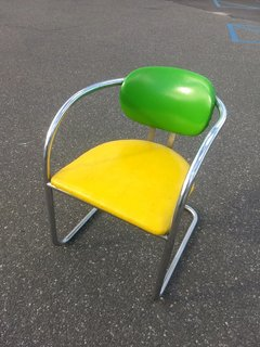We love the atomic, almost futuristic design of this bright yellow and green armchair from the 1960s.