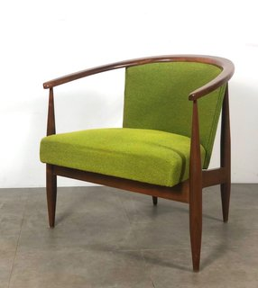 This barrel-backed armchair has clean lines and original lime green upholstery.