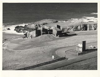 Condominium #1, one of the first buildings constructed at Sea Ranch, and south entrance marker along Highway 1 in 1965. The double wave or curlicue logo can be seen at the entrance marker and was frequently used on buildings and branding material throughout the community.