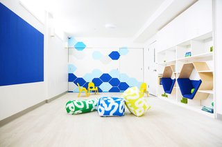 Working with architect Dennis George, interior design firm Ishka Designs provided a comprehensive interior design solution for the gut renovation of a former thrift store into Discovery Pitstop Daycare. The bold yet minimalist design employs colors and forms to create a space that is both fun and inspiring but also simple, clean, and calm.