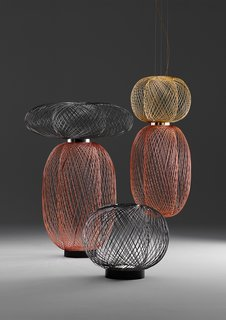 Designed by industrial designer Stephen Burks, the Anwar Lighting for Parachilna is made of brass, copper, and graphite electroplated steel wire with an LED light source. The pieces were hand made in Spain.