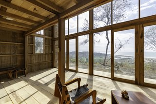 The floors, structure, window frames, and walls are all made of wood.