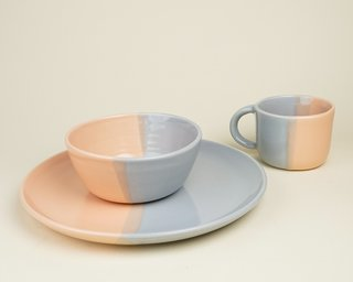 A dipping technique is used to glaze this set of dishware by potter Helen Levi.