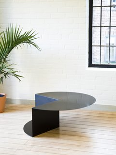 Cho's background in furniture design is evident in her pieces, which explores reductive forms to the point where they strike a balance between furniture and artwork. Her Cantilever Table started with the planar material of sheet metal and developed ideas about folding and bending to create a simple but dynamic, three-dimensional form.
