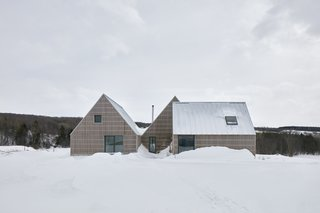 A Gabled Trio Forms This Barn-Inspired Home in Quebec