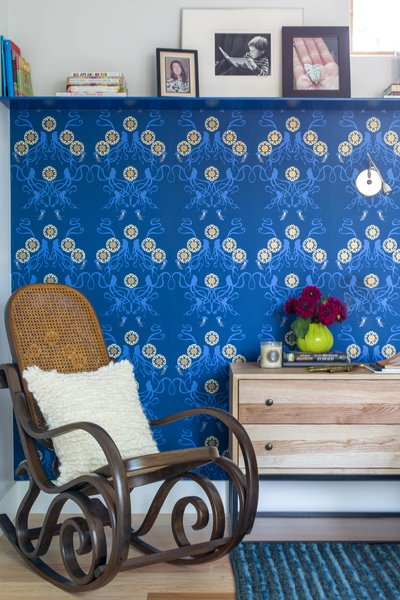 The wallpaper used in the master bedroom is Captain Smith Promenade. An antique Thonet Bentwood Rocking Chair, which has been in the family for generations, sits in the corner of the room.